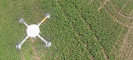 drone flying over a farm