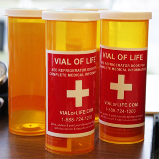 Yellow Vial of Life capsules with important medical information secured inside.