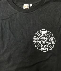 Front of navy Gerrish Fire Department Tshirt with white fire department crest on left breast.