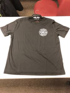 Front of Black Gerrish Fire Department Tshirt with white fire department crest on left breast.