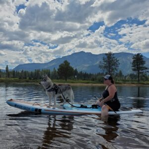 Heather and her dog Timber on a paddleboard