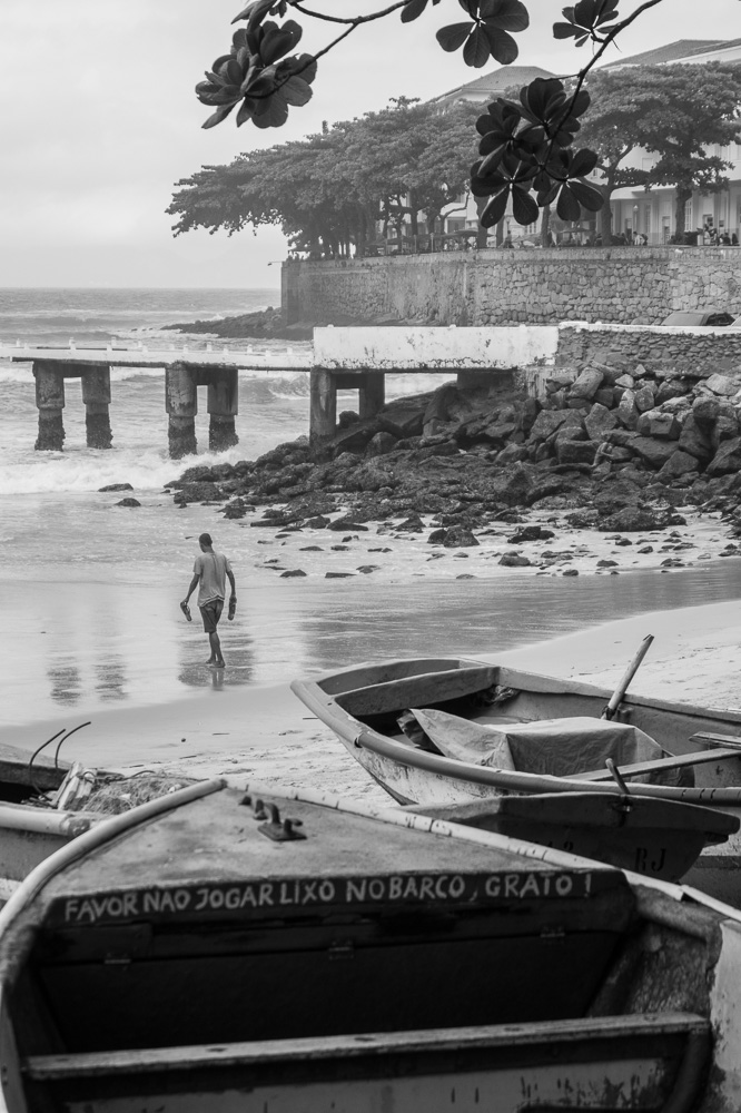 Boat in Copacabana Beach with Fisherman in the background