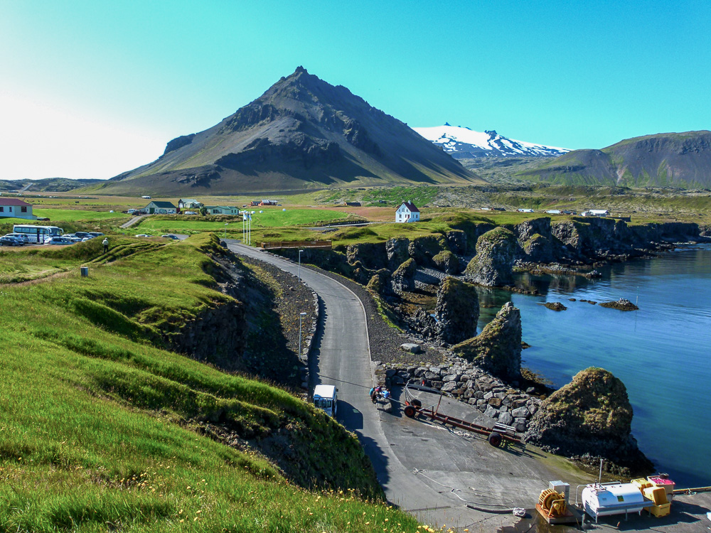 Fishing village of Arnarstapi with Mt. Stapafell and Snæfellsjökull volcano in the background