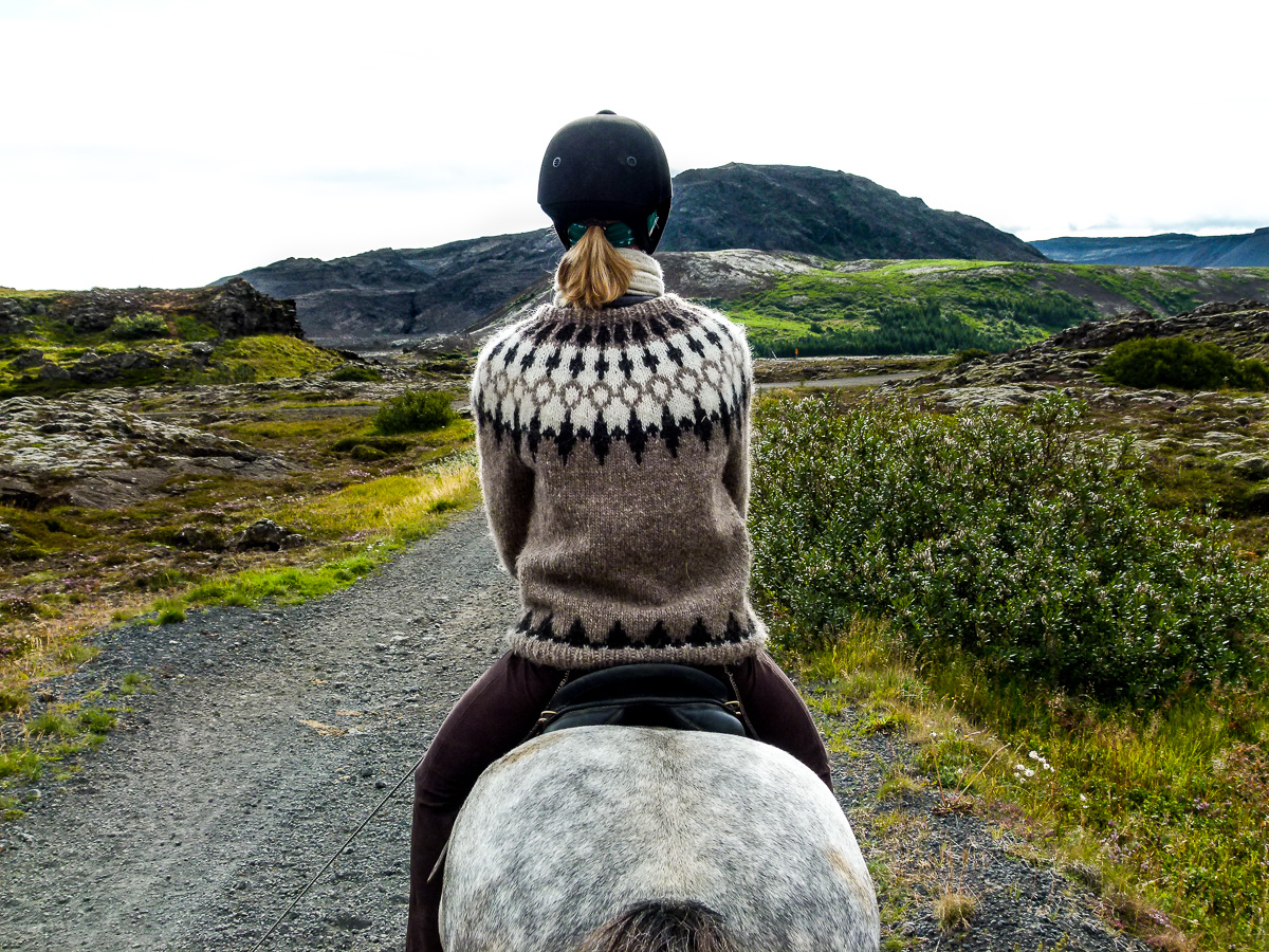 Horse Riding through lava fields in Iceland