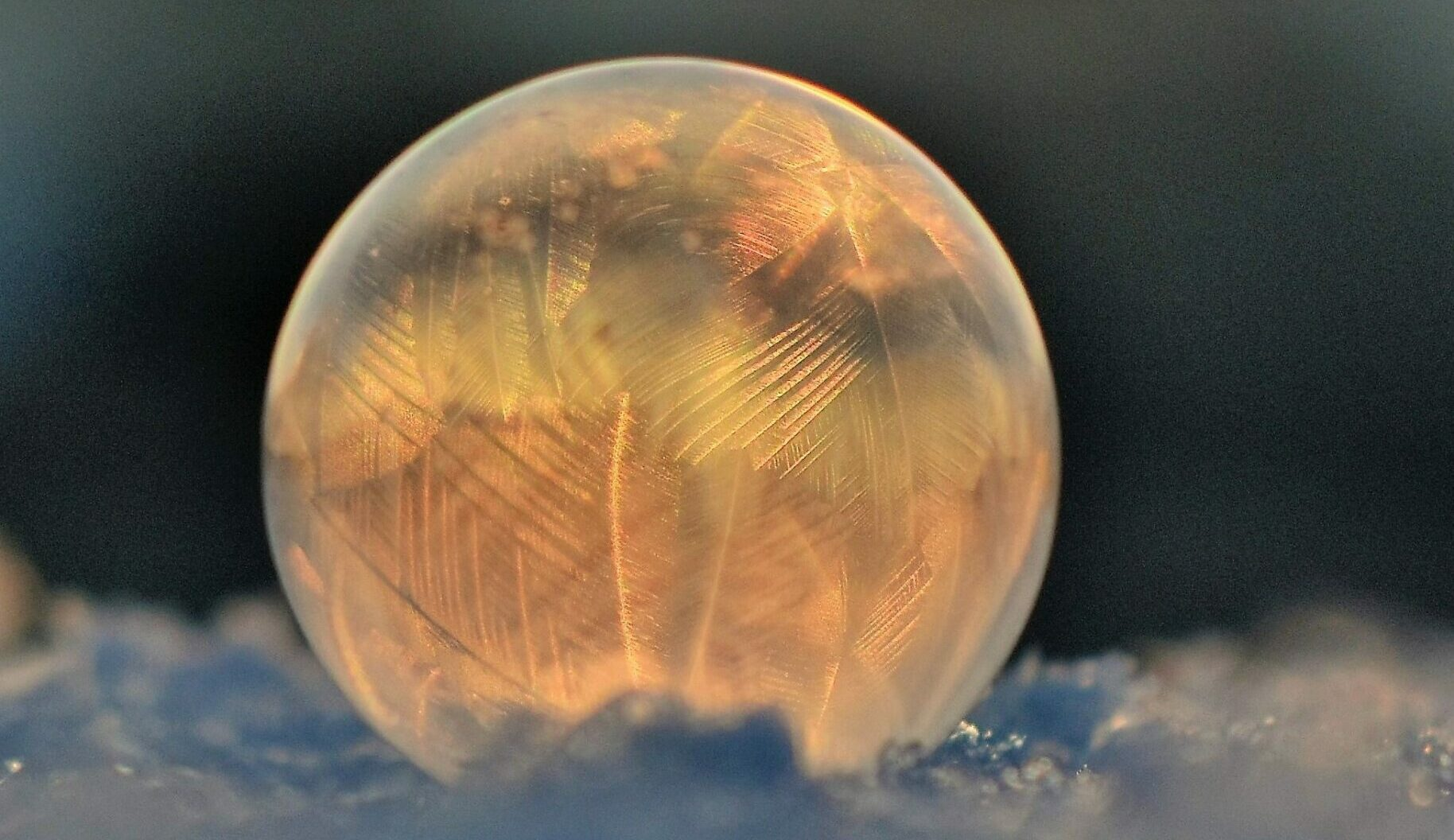 frozen-soap-bubble-against-sky-during-sunset