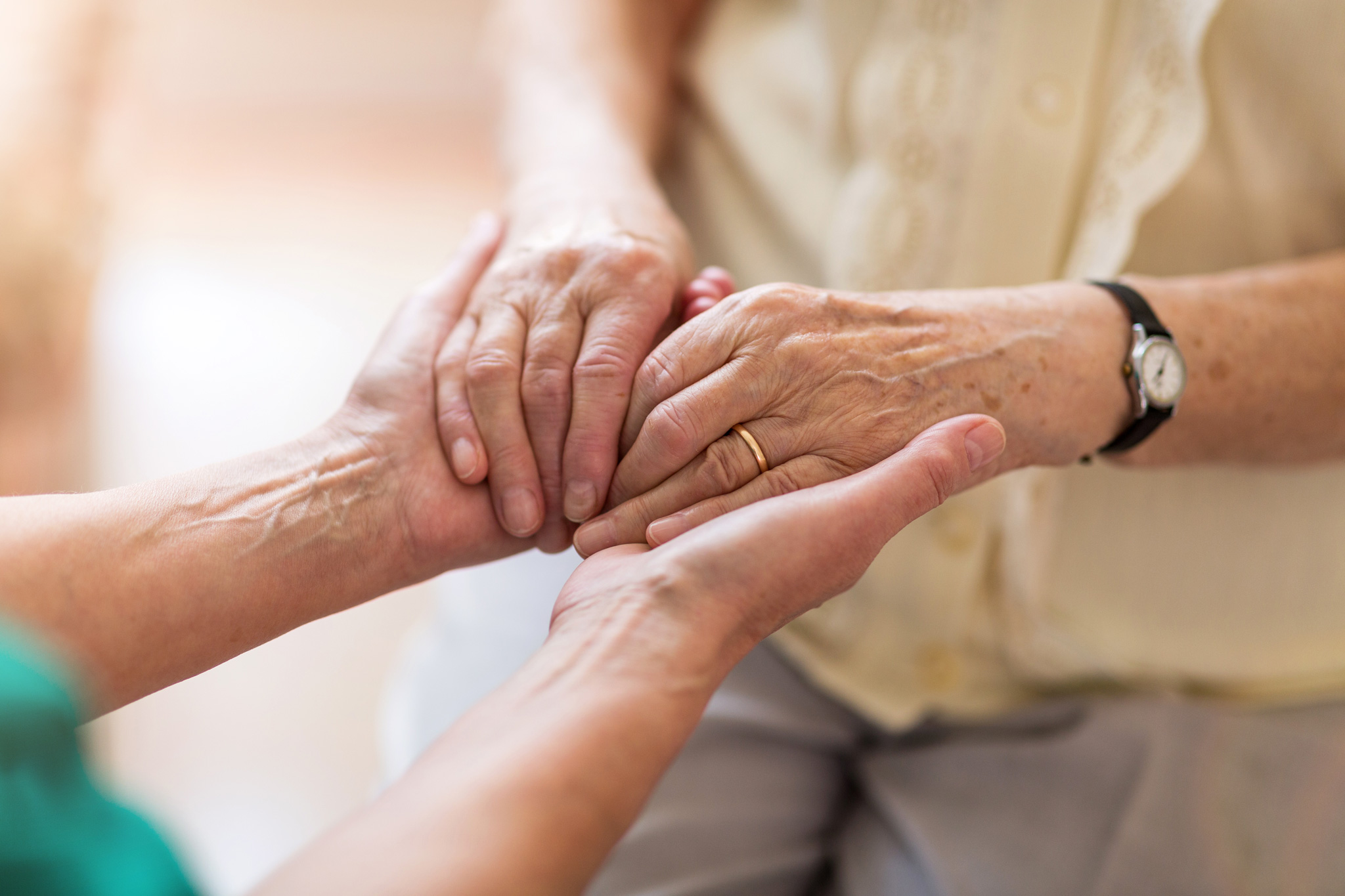 hands of elderly woman with caregiver