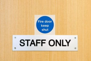 staff only door sign outside workplace