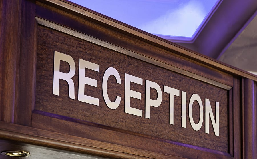 Golden reception bell and reception sign