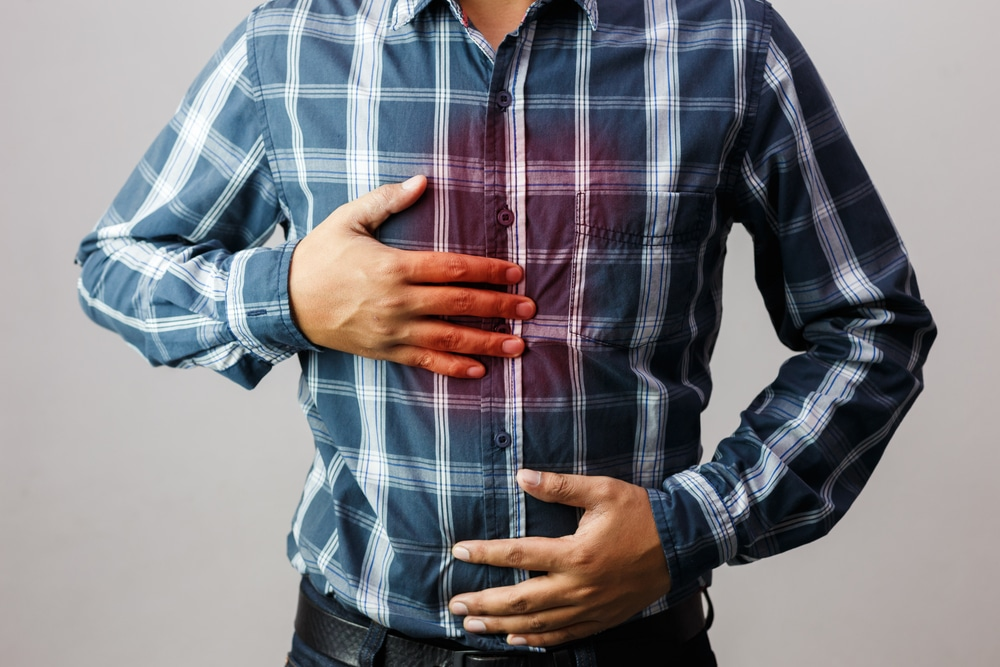 Men having heartburn in the middle of the chest due to acid reflux