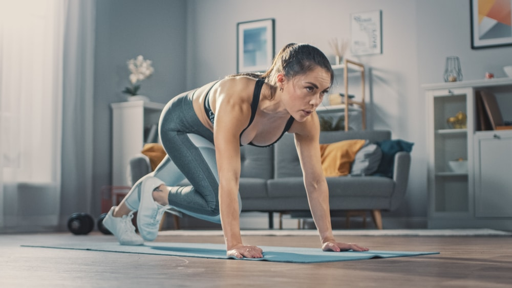 Women doing cardio workout at home