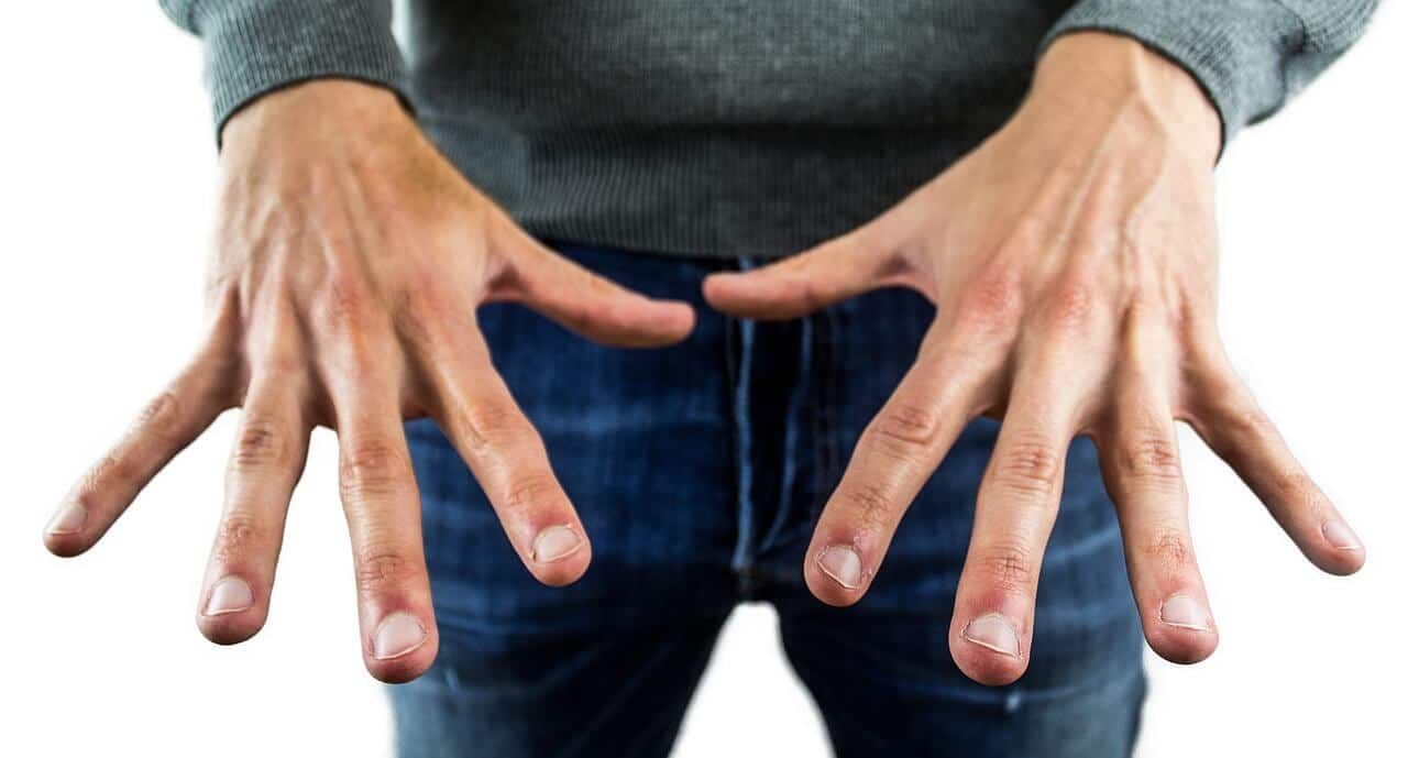 man showing his finger nails