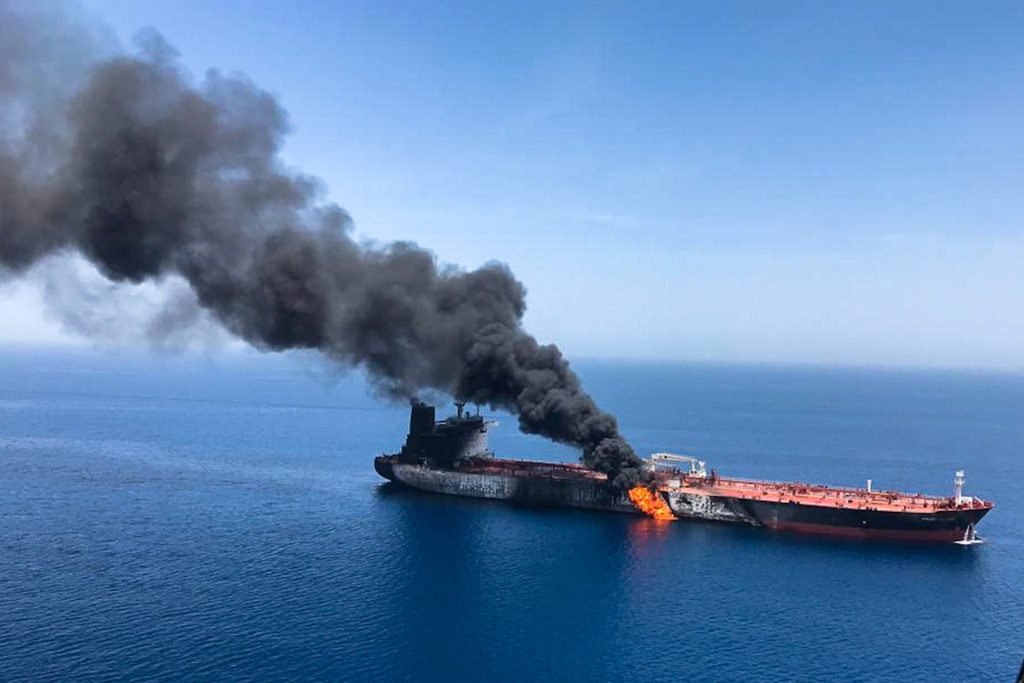 Iranian vessel seen removing unexploded mine from oil tanker