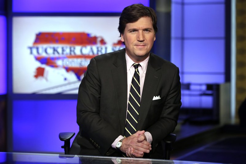 Fox's Carlson denounces ex-writer, 'self-righteous' critics