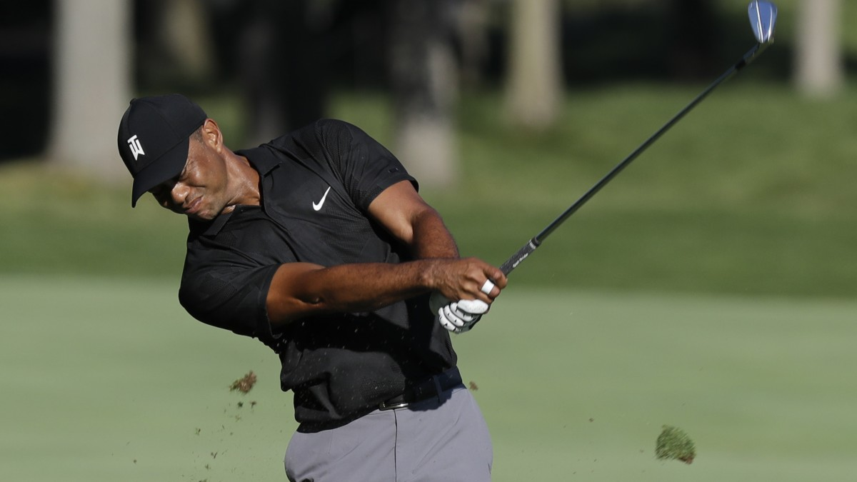 Tiger Woods' round surrounded by silence an eerie feeling