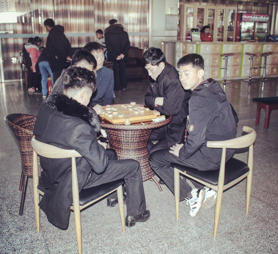 Locals play Korean board game Janggi, in Rason Gymnasium Leisure Centre
