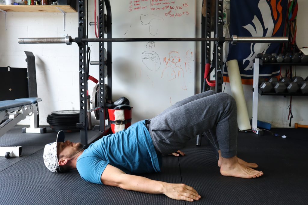 Bridge leg extensions for back and core strength
