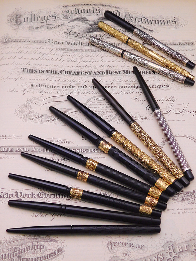 2 taper cap pens on writing page lo res