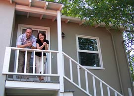 Owners Breton and Karrie Buckley on the steps of their peaceful bed and breakfast in San Diego.