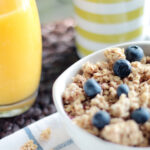 Canva - Bowl of Oatmeal With Berries Beside Glass of Juice