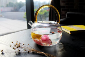 Canva - Transparent Teapot with Flowers