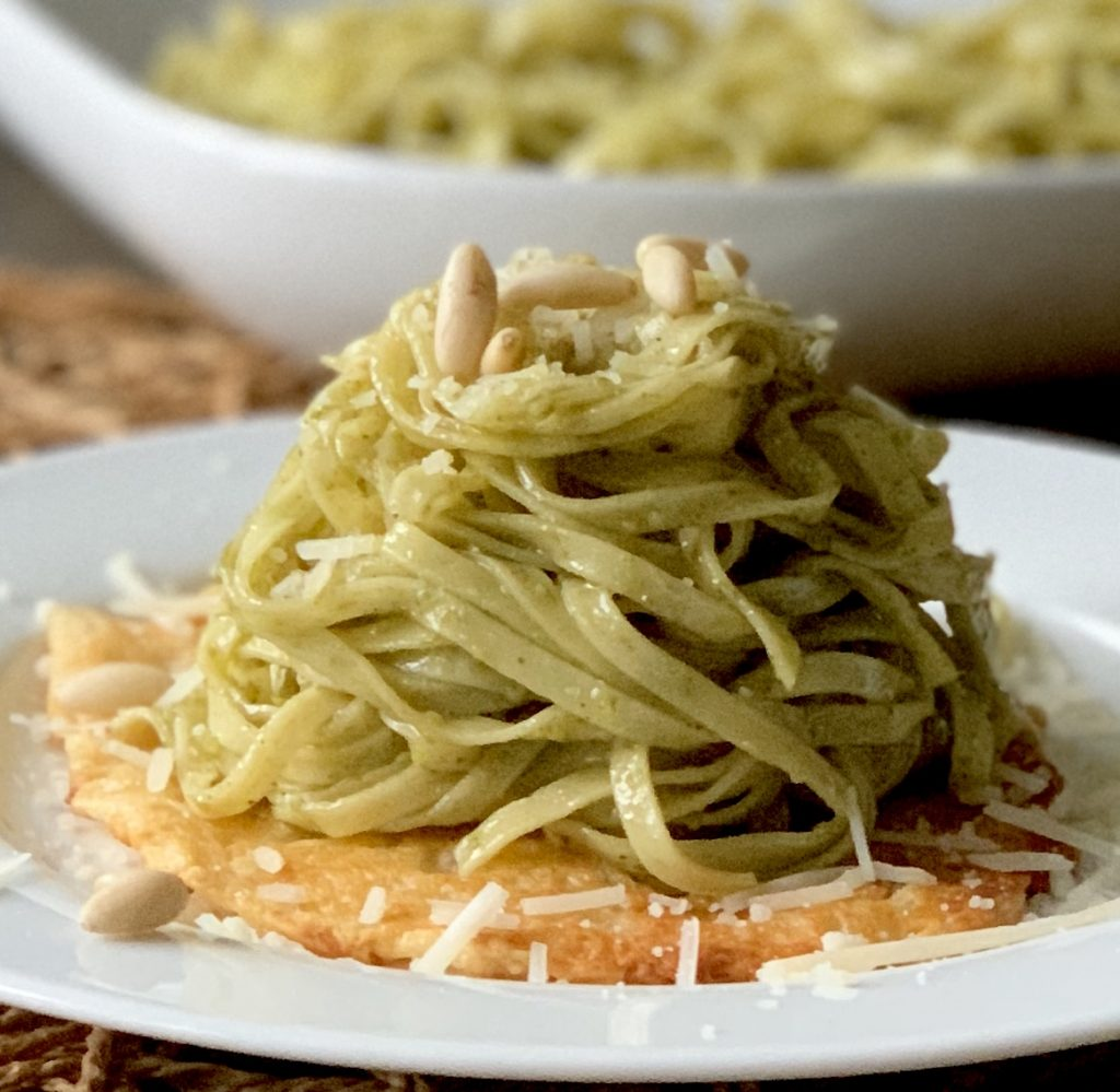 Basil Pesto Pasta over Parmesan Frico