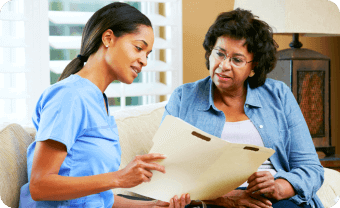 caregiver reminding her patient about her medications