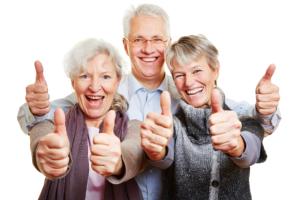 elders showing their thumbs up