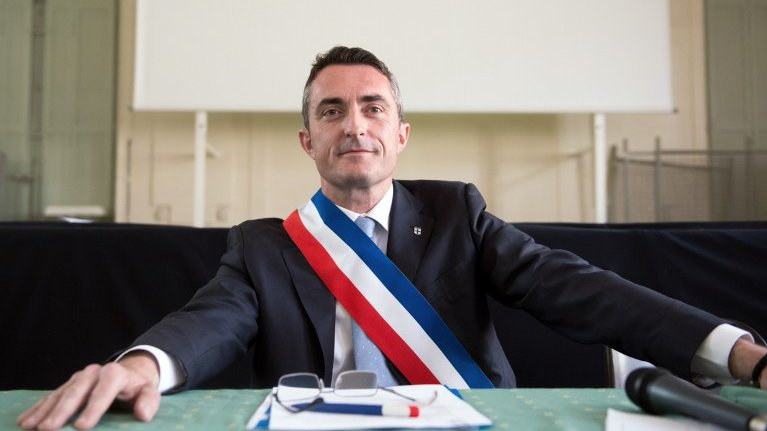 Thumbnail for the post titled: French Senator Blames NWO For Migrants Overrunning Country