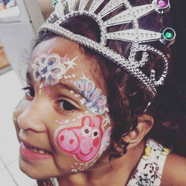 A young girl at a princess party with some face painting