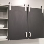 kitchen cabinet with Goldberg Brothers Shutter Series barn door hardware and MClad® cabinet facing