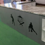 MClad steel retail counter console with logos