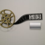 decorative office suite sign made from a 16 millimeter film reel