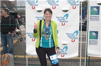 Andreea G posing with her finisher's medal after a marathon race