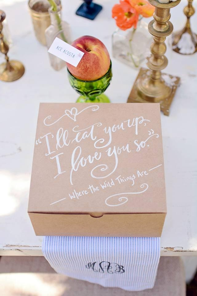 """I'll Eat You Up. I love you so."" A sweet message written in script decorates the lids of individual craft paper food boxes."