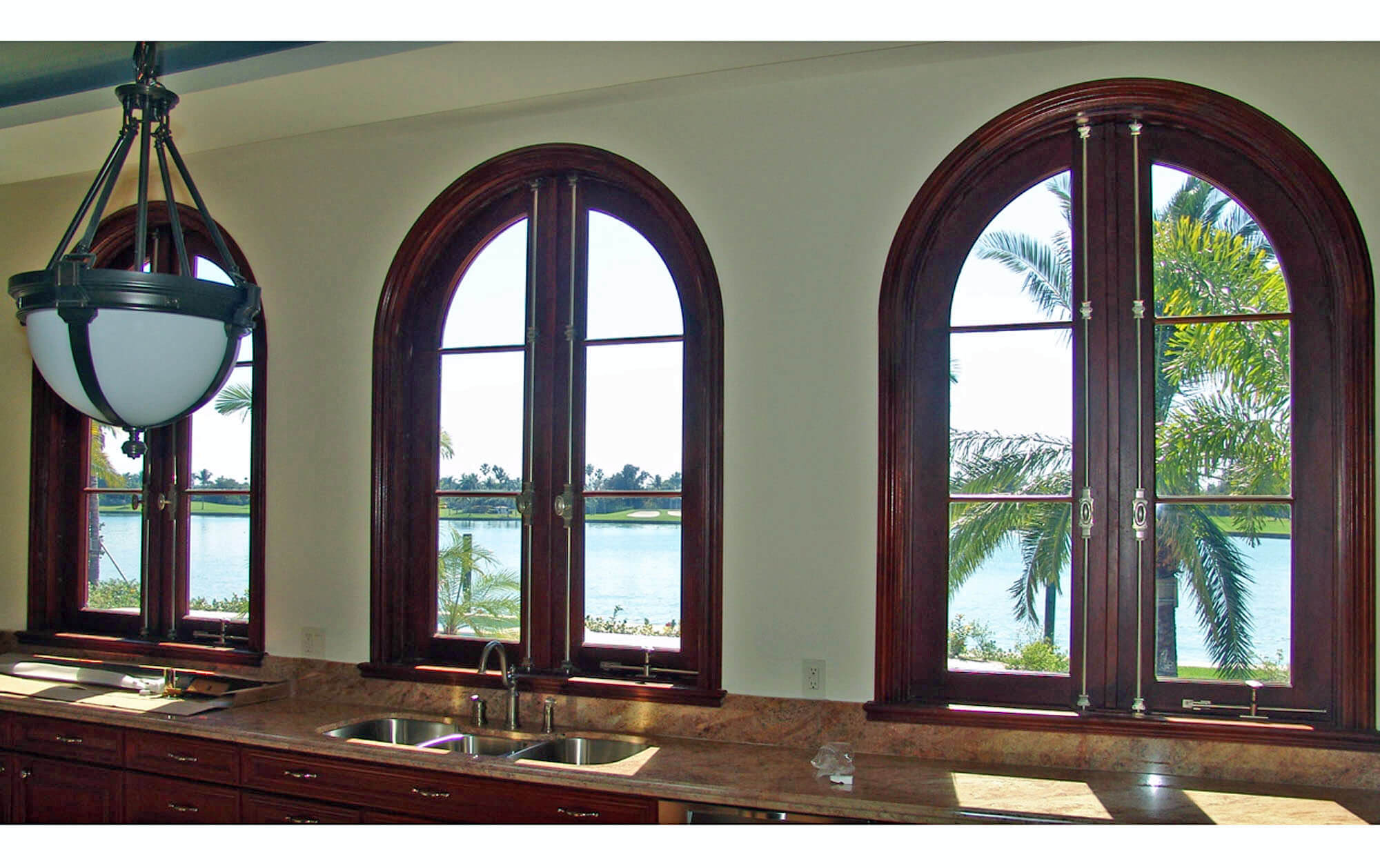 BAL HARBOUR MAHOGANY ARCHED CASEMENT.