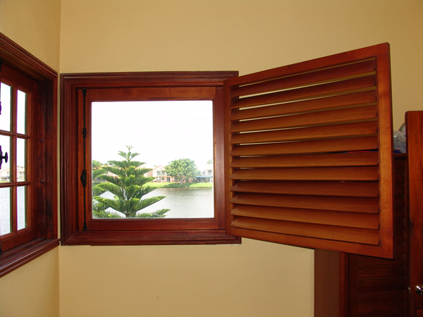 LAKE HOUSE SHUTTERED WINDOW