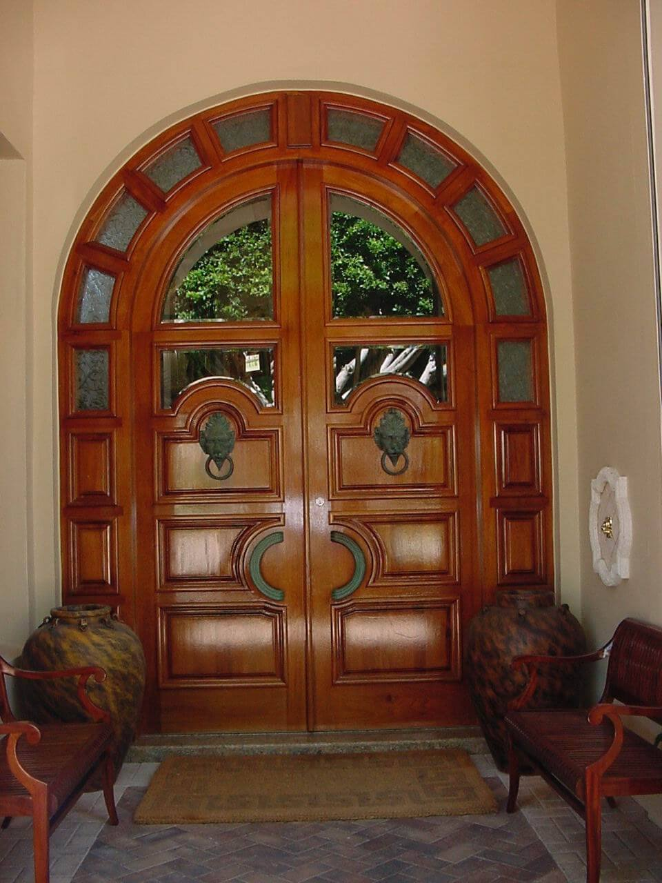 LIGHTHOUSE POINT. MAHOGANY FRONT DOORS.