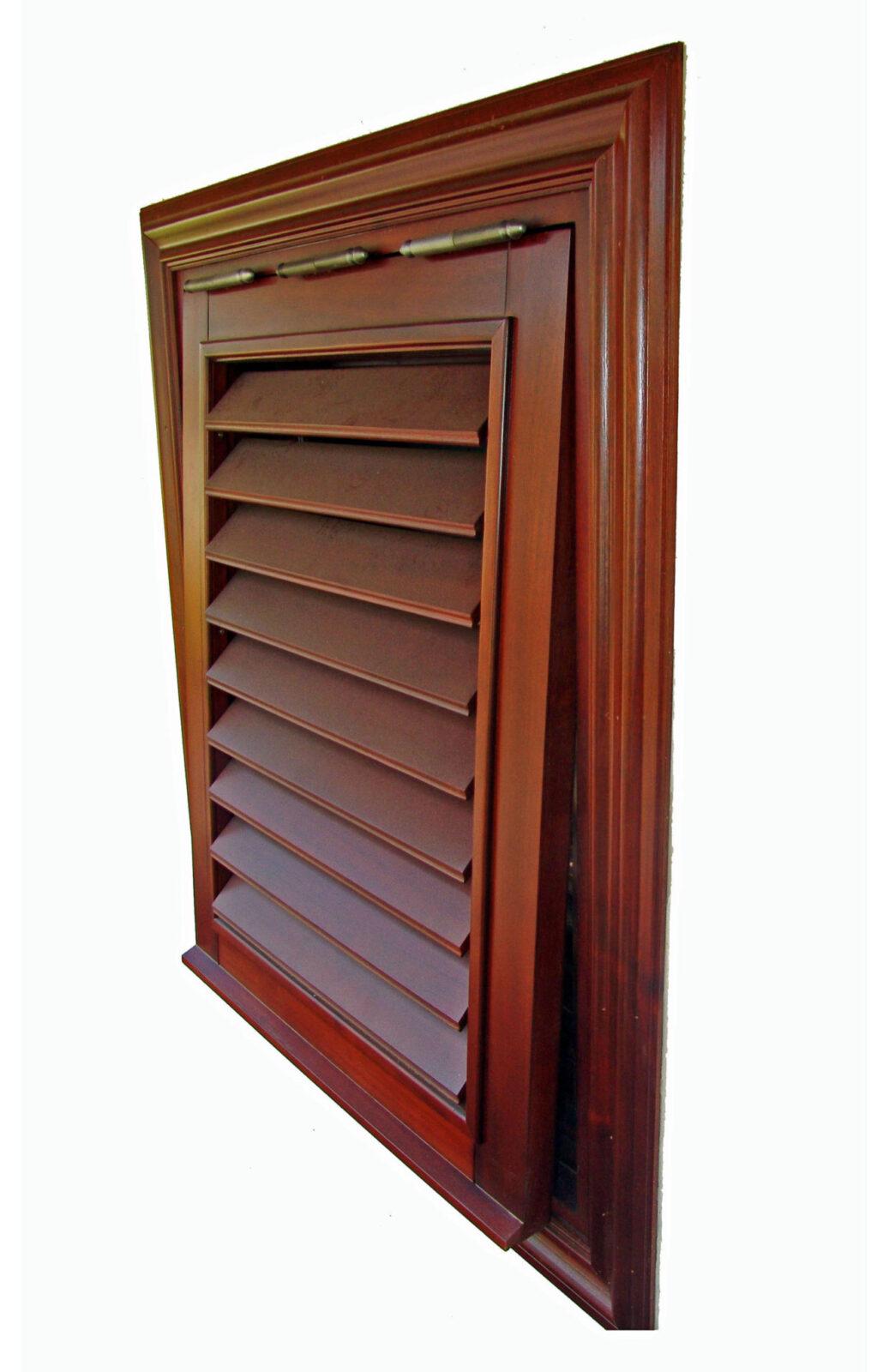 MARTINIQUE MAHOGANY SHUTTERS ON CASEMENT WINDOW