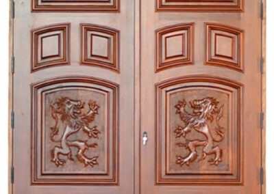 INDIAN CREEK VILLAGE. MAHOGANY CARVED DOORS.