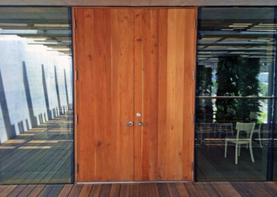 BISCAYNE POINT. DOUBLE LEAF MAHOGANY PLANK DOOR.