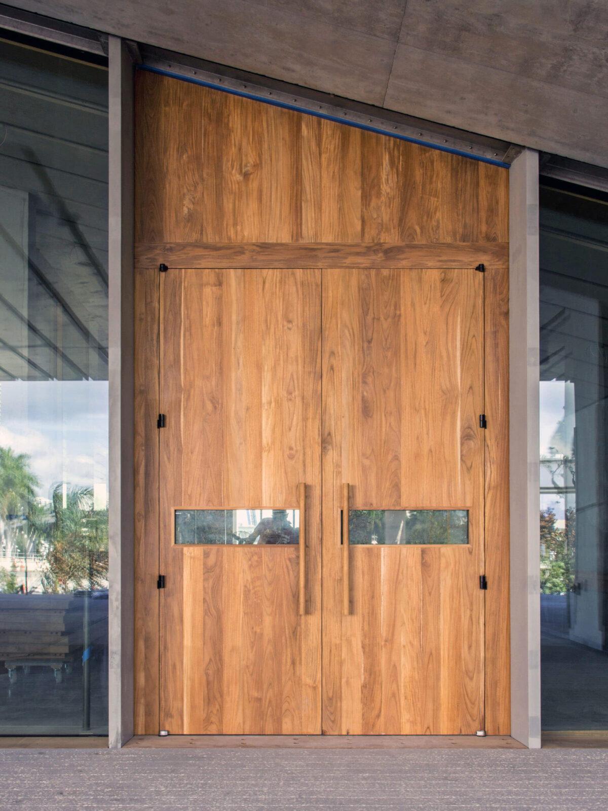 TEAK ENTRANCE DOORS TO RESTAURANT.