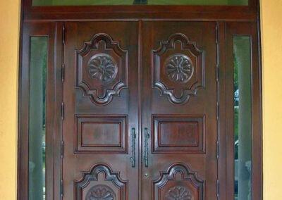 COCO PLUM. MAHOGANY ENTRANCE DOORS.