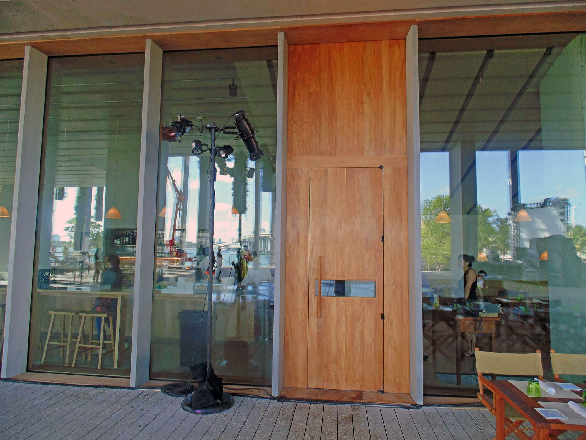 TEAK ENTRY DOOR TO RESTAURANT.