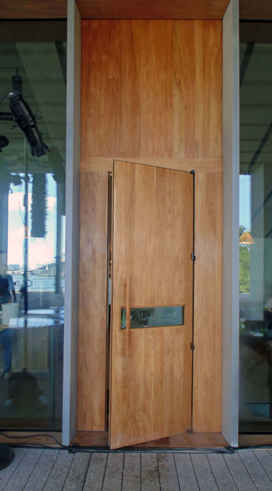 TEAK EXTERIOR DOOR FOR THE PEREZ MUSEUM OF ART.