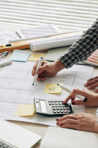 Hands of architecs counting budget for the project