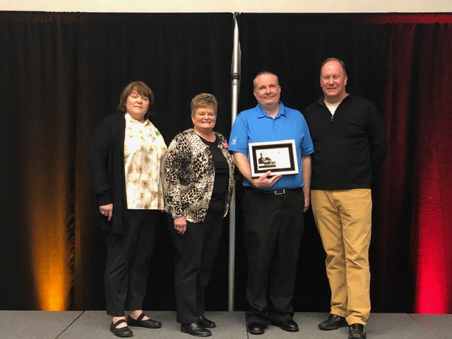 Chris Williams receives Outstanding Manager Award from McDonald's®