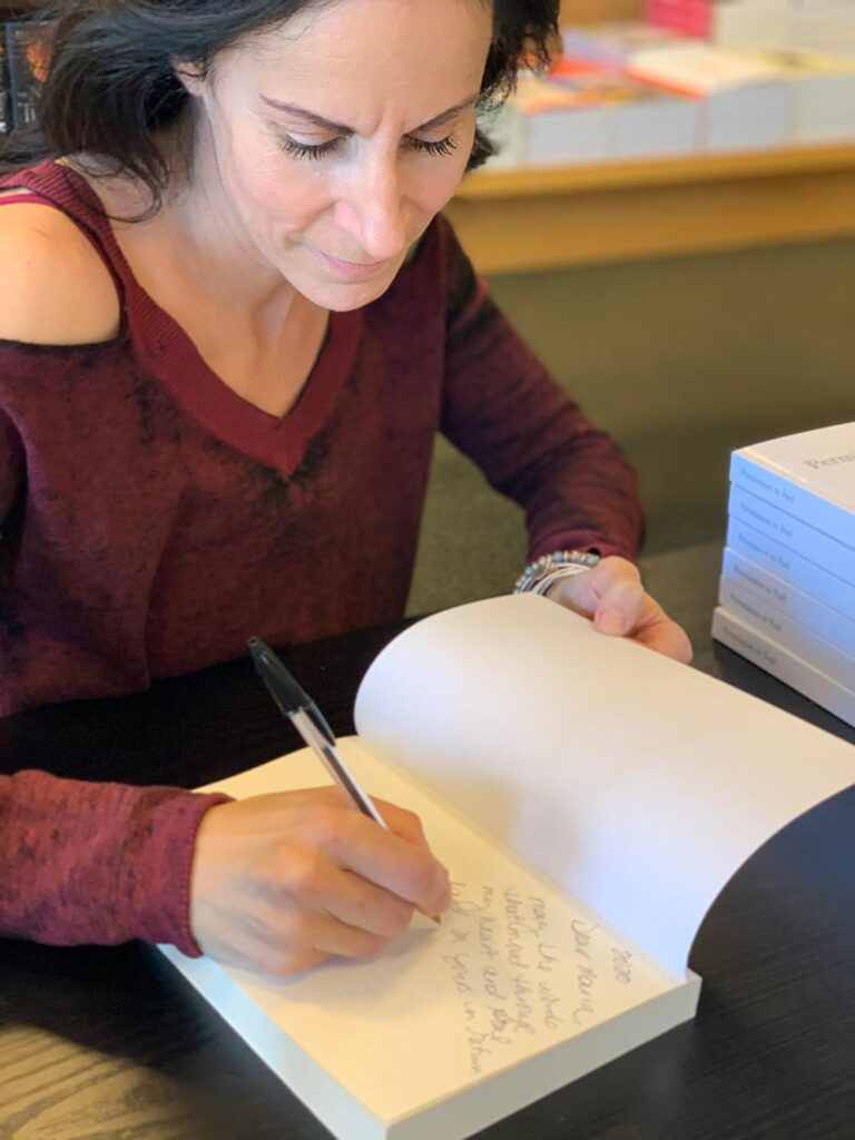 Sandra and Her Autographed Copies for Avid Readers and Fans