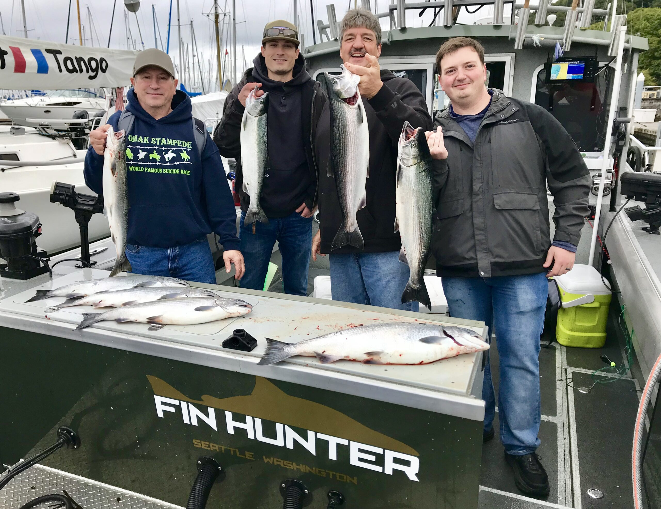 Father And Sons Fishing In Seattle