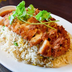 Breaded fried chicken top on Thai fried rice.