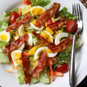Thai style salad with bacon and egg.